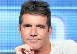 tomlinson cowell trying to form girl band