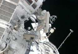 astronauts go spacewalking to hang station shields
