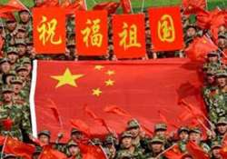 china celebrates 65th anniversary as protests continue in