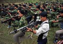nepal maoists hand over weapons to special committee