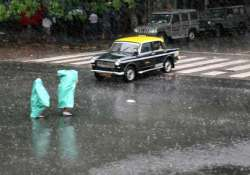heavy rains cripple life suburban train services in mumbai