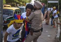 tibetans stage protest outside taj palace over xi s india