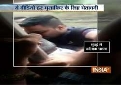 caught on camera 21 year old falls off overcrowded mumbai