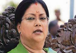 raje demands apology from rbi governor