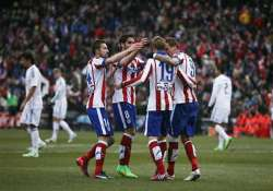 atletico thrashes real madrid 4 0 in derby to open up title