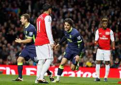 wigan beats arsenal 2 1 to boost survival hopes