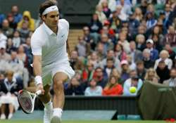 federer beats malisse to reach wimbledon quarters