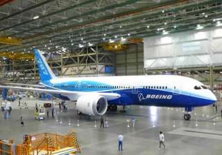 boeing agrees to pay compensation to ai for...