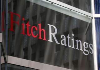 fitch lowers india s credit rating outlook to...