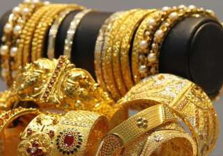 gold down by rs 330 silver by rs 100 on lower...