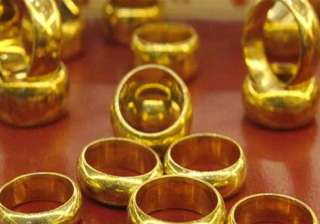gold prices fall on subdued demand global cues -...