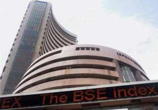sensex dives 261 points on muted earnings tax...
