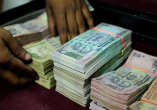 rupee falls 35 paise to 61.79 against dollar as...