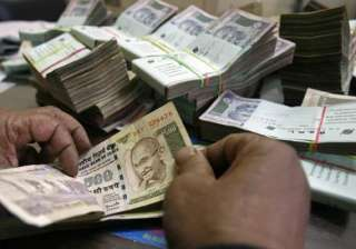 rupee sinks to an all time low of 64.15 against...
