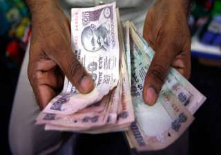 rupee up 29 paise to seven week high of 61.44...
