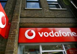 vodafone facing tax liability of over rs 27 000...