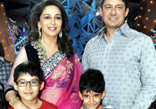 my kids are untouched by my fame madhuri dixit...