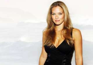 bar refaeli poses topless in war themed issue of...