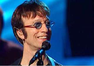 bee gee robin gibb wakes from coma - India TV