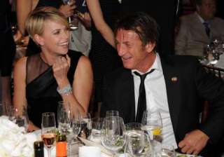 charlize theron sean penn to adopt a child -...
