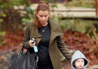 coleen rooney protecting house from spider by...