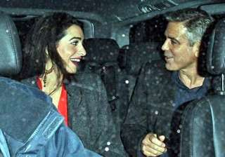 george clooney goes on a secretion vacation with...