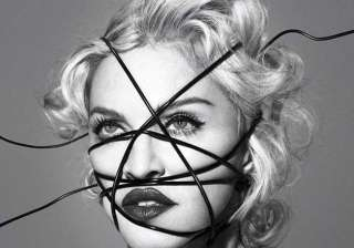 madonna defends altered photos of martin luther...
