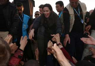 angelina jolie meets isis victims in refugee camp...