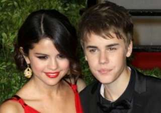justin bieber supports miley cyrus - India TV