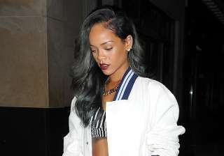 rihanna sued over grandmother s funeral bill -...