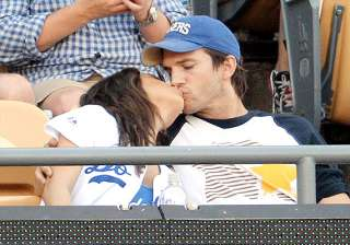 mila kunis ashton kutcher kisses each other...