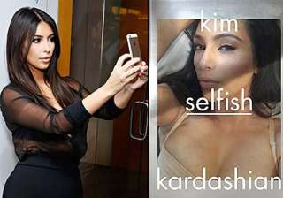kim kardashian flaunts cleavage for selfish -...