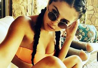 brave selena gomez posts selfie in skimpy orange...