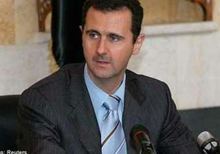 assad issues decree forming new syria government...