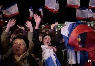 crimea votes yes to reunification with russia in...