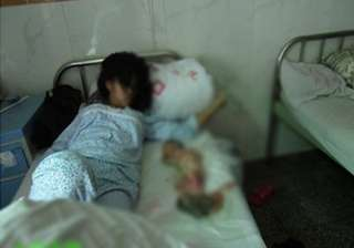 family in forced abortion case harassed in china...