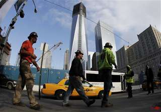 final steel beam lifted at 4 world trade center -...