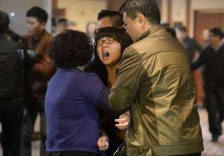 grief lingers as search for lost jet continues -...