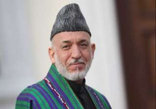 hamid karzai casts vote in presidential runoff...