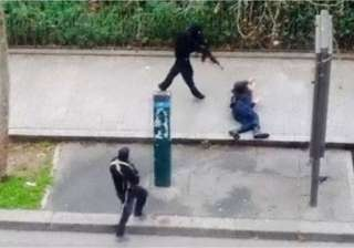 charlie hebdo attack cop killed on pavement...