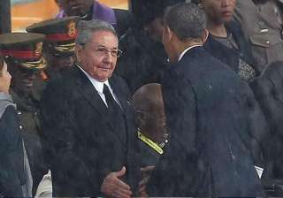 us president obama and his cuban counterpart raul...