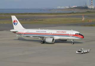china travelers open emergency exits to protest...