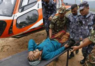 helicopters ferry injured from nepal villages...