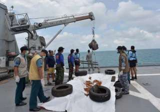 airasia crash search personnel lift plane s tail...