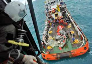 divers examine airasia jet fuselage search for...