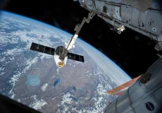 unmanned russian spacecraft plunging towards...