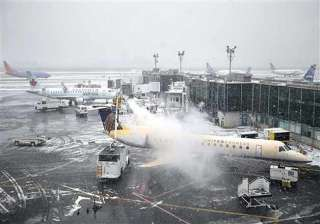 thousands of flights canceled as us braces for...