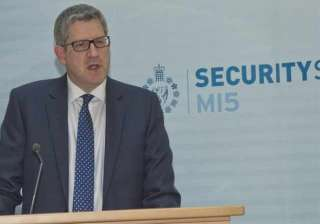 britain s spy chief warns of mass attacks on west...