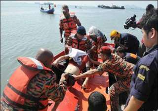 66 indonesians missing after boat sinks off...