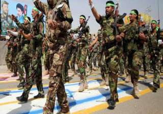 iraq militia parades as insurgents seize crossing...